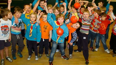 Scouts taking part in charity dodgeball .