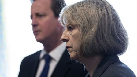 Former Prime Minster David Cameron and then home secretary Theresa May. Photograph: Oli Scarff/PA.