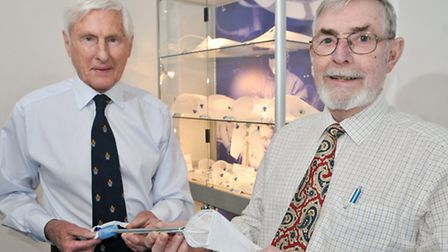 Harry Espiner and Jim Howard with the medical device their company produces.