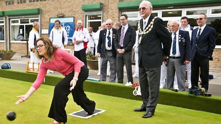 Alison Harwood from Sponsor Optika bowling the first wood watched by Mayor Keith Morris, tournament