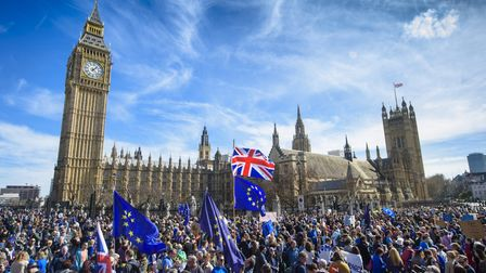 Anti-Brexit campaigners outside the Houses of Parliament