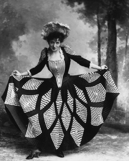 Actress, dancer and singer Lottie Collins (1866 - 1910) curtseying. She is famous for the song 'Ta R