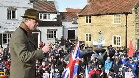 Nigel Farage speaks to Brexit supporters in the car park of the Horse and Groom in Linby, in Notting