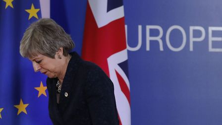 British Prime Minister Theresa May leaves after addressing a media conference at an EU summit in Bru