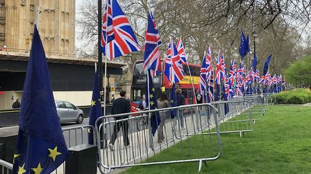 A row of Union flags in a spot usually occupied by EU flags opposite the Houses of Parliament. Photo