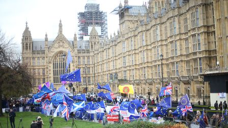 Anti-Brexit and Pro-Brexit protesters flying flags outside the Houses of Parliament on a typical day