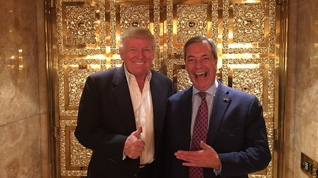 Anti-elitist elite Donald Trump and Nigel Farage in a gold lift at Trump towers. Photograph: Getty.