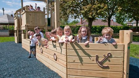 Children enjoying the new pirate ship play equipment at Golden Valley Primary School.