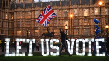 People's Vote campaigners outside the Houses of Parliament. Photograph: Victoria Jones/PA Wire