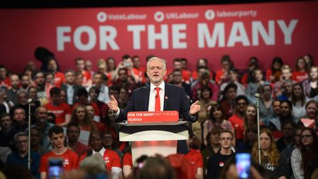 Labour leader Jeremy Corbyn speaking in front of supporters. Photograph: Joe Giddens/PA.
