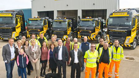 Towens staff and owners with some of their new vehicles outside the new workshop.