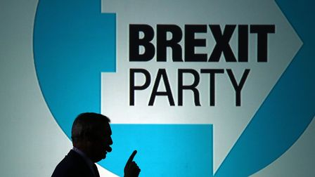 Nigel Farage delivers a speech at a Brexit Party rally at Brighton City Airport in West Sussex. Phot