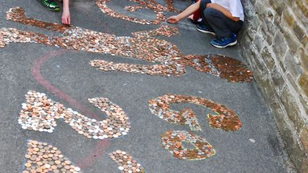 All Saints Primary School ,Clevedon pupils with Large bike mosaic coins donated to the school f