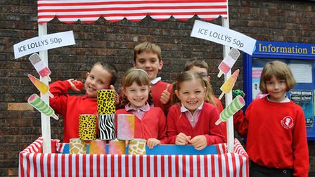 Year 2 pupils at one of the stands that was built for the fair.