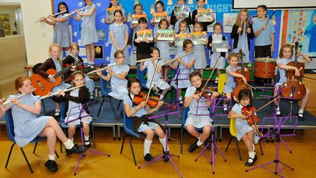 Pupils from St Francis School rehearsing for the summer concert.