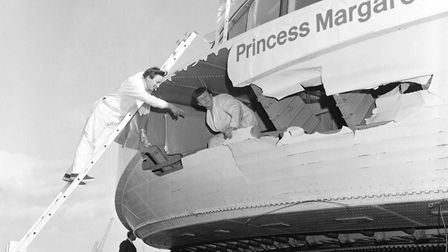 Workers check damage to the Princess Margaret hovercraft caused by vigorous waves in 1968. Picture: