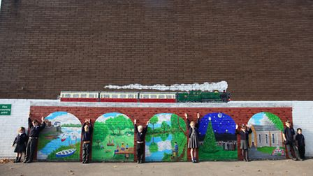 Pupils with the Crockerne Primary School mural.