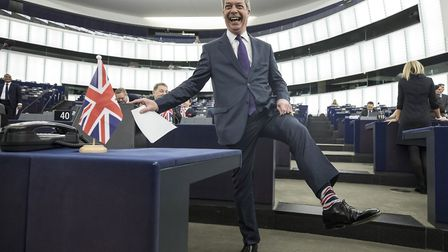 Brexit party leader and member of the European Parliament Nigel Farage shows his socks at the Europe