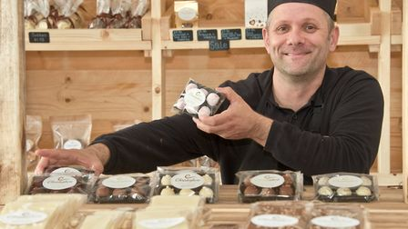 Proprieter Christopher Hawkins making and selling his handmade chocolates.