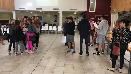 Students receiving their results.