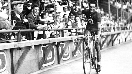 Italian racing cyclist Gino Bartali celebrating his Tour de France victory, 31st July 1938. Photo by