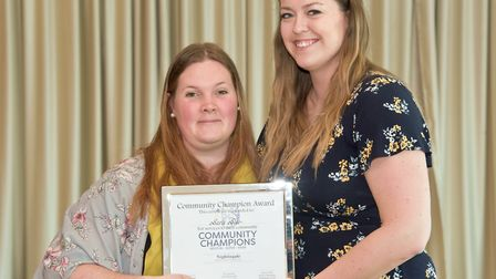 Sara Slee presented with her award by Eleanor Young from the Weston Mercury.