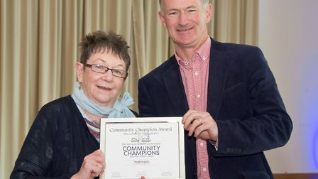 Babs Tulip presented with her award by Weston's MP John Penrose.