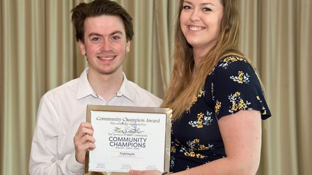 Alex Crowther presented with his award by Eleanor Young from the Weston Mercury.