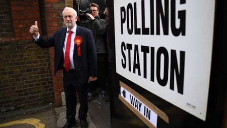 Labour party leader Jeremy Corbyn gives the thumbs up as he leaves a polling station. (Photo by Leo