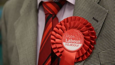 A Labour rosette is worn in support of the party during an election count. Photograph: Daniel Leal-O