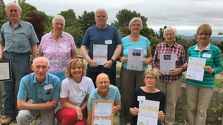 Health walk leaders with their awards for long service.
