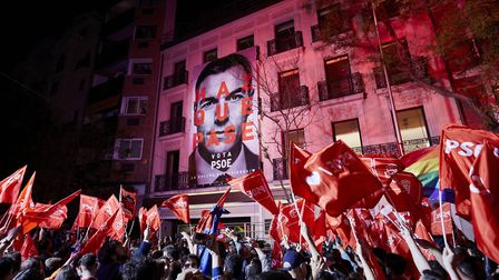 Supporters gather outside of the PSOE (Spanish Socialist Workerss Party) headquarters in Madrid. Pho