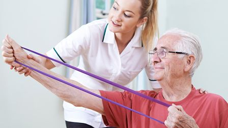 Senior Male Working With Physiotherapist. Picture: HighwayStarz