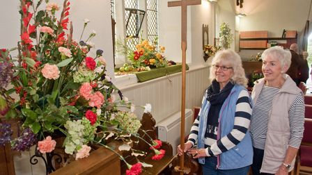 Glen Browne and Carol Legge enjoying the displays at St Barnabus Church flower festival. Picture: