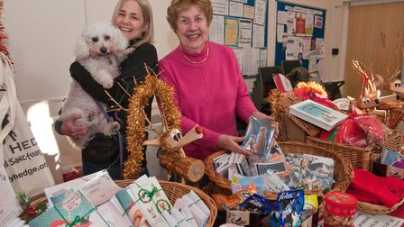 Nicky, Pat and rescue dog Ella at Holly Hedge Animal Sanctuarys Christmas fair.Picture: MARK ATHERTO