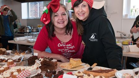 Ginny Matchwick and Jenny Green serving cakes and refreshments at Holly Hedge Christmas fair.Picture
