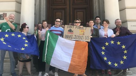 People gather at a rally dubbed #WeAreIrishToo outside the Northern Ireland Office on Saturday on Ho