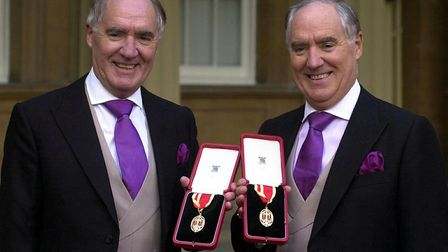 Multi-millionaires Sir David Barclay (left) and his twin brother Sir Frederick after receiving their