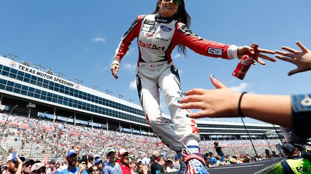 FORT WORTH, TX - APRIL 09: Danica Patrick, driver of the #10 TaxAct Ford, greets fans during driver