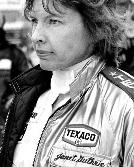 DAYTONA BEACH, FLORIDA - FEBRUARY 1980: NASCAR driver Janet Guthrie talks with crew members prior t