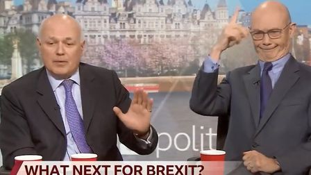 Pascal Lamy appears to mimick a unicorn behind Iain Duncan Smith's back. Photograph: BBC.
