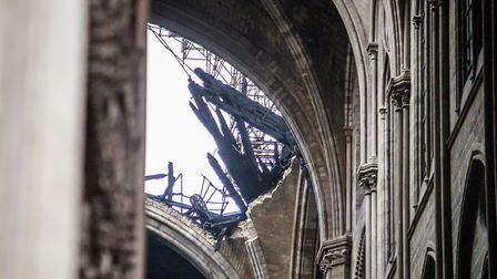 A hole is seen in the dome inside the damaged Notre Dame cathedral in Paris, Tuesday, April 16, 2019