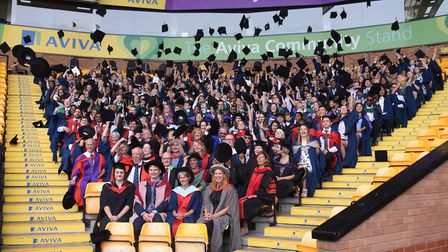 Students throw their caps at their graduation ceremony. Picture: DENISE BRADLEY