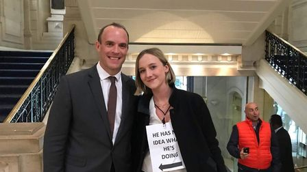 Dominic Raab with an anti-Brexit campaigner (Photograph: OFOC)