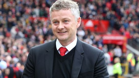 MANCHESTER, ENGLAND - APRIL 28: Manager Ole Gunnar Solskjaer of Manchester United walks out ahead of