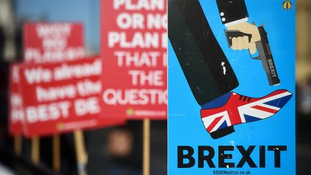 Anti-Brexit campaigners' placards outside the Houses of Parliament