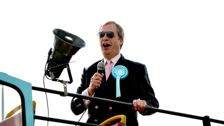 Brexit Party leader Nigel Farage on an open topped bus in South Ockendon (Joe Giddens/PA Wire)
