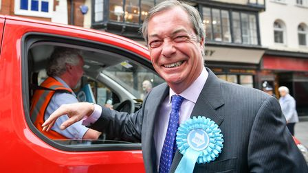 Brexit Party leader Nigel Farage laughs before the incident (Ben Birchall/PA Wire)
