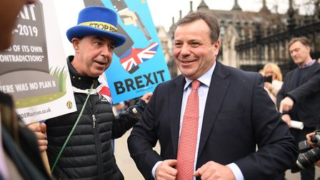 Businessman and co-founder of the Leave.EU campaign, Arron Banks speaks with demonstrators outside t