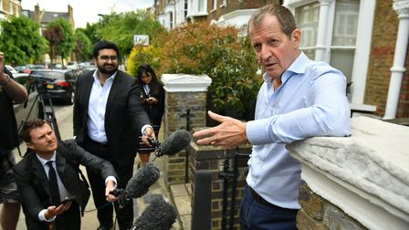 Alastair Campbell speaks to the media outside his home in north London after he was expelled from th